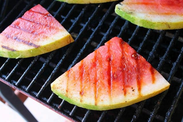 Wedges of watermelon being grilled.