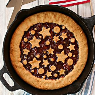 Strawberry-Peanut Butter Tart! If you're looking for easy peanut butter dessert recipes, look no further! This All-American tart boasts the flavors of a classic PB & J in tart form! A great take-along for summer potlucks, Memorial Day and the 4th of July.