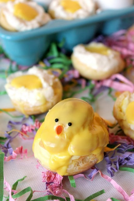 These adorable little Easter chicks are sweet cream-filled cream puffs with a sweet vanilla glaze