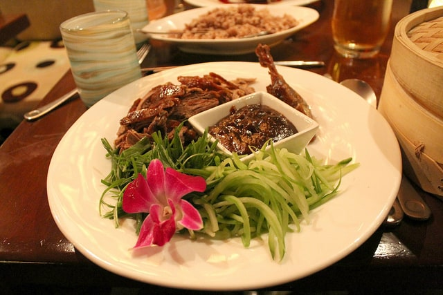 Peking Duck at Echo Restaurant in Palm Beach, Florida. Housemade Mandarin Pancakes, Cucumber, Scallion, Hoisin Sauce