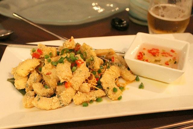 Salt & Pepper Calamari at Echo Restaurant in Palm Beach, Florida. Sliced Calamari Steak, Scallion, Thai Chili, Crushed Black Pepperwith Sweet & Sour Dipping Sauce