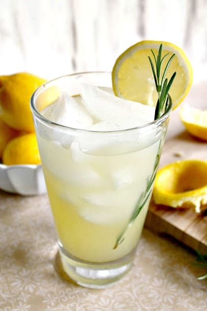 Vanilla-Rosemary Lemonade! This fresh lemonade recipe gets a flavor upgrade with the addition of real vanilla bean and fragrant rosemary. A perfect sipper for showers, parties and summertime porch sittin'!