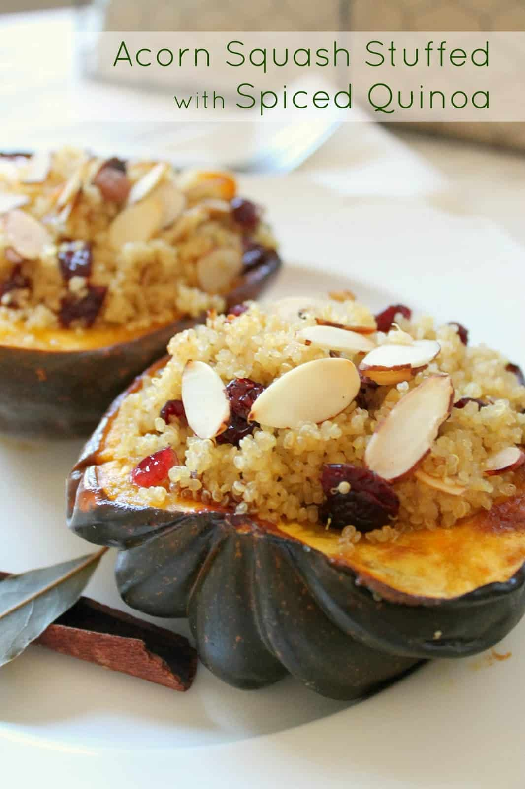 Close up of stuffed acorn squash with bay leaves.