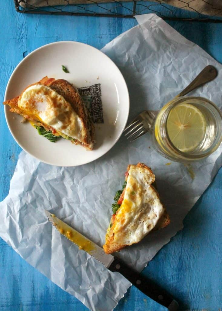 topped with a fried egg, this bacon avocado sandwich is a delicious brunch option