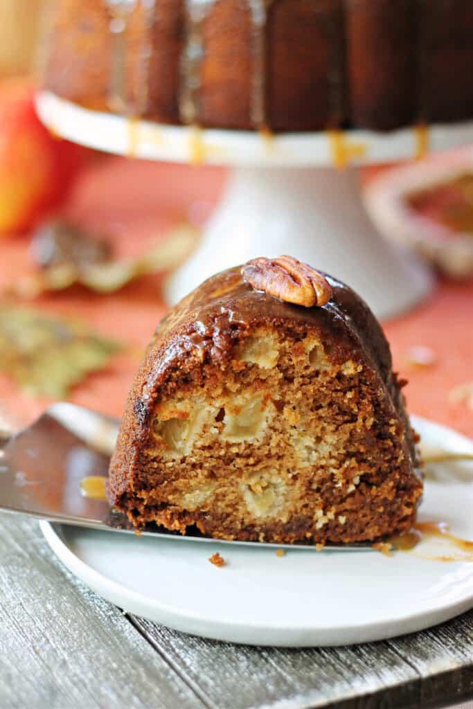 A slice of Honey Apple Bundt Cake on a white plate.