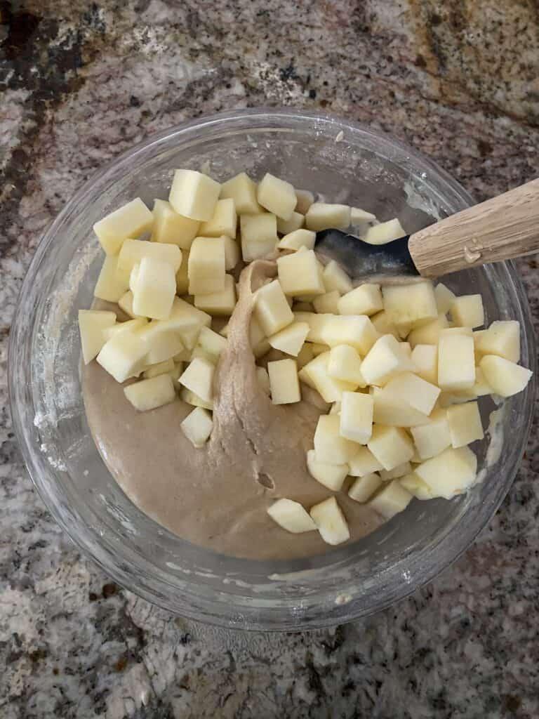 Adding honeycrisp apples to the batter for Honey Apple Bundt Cake