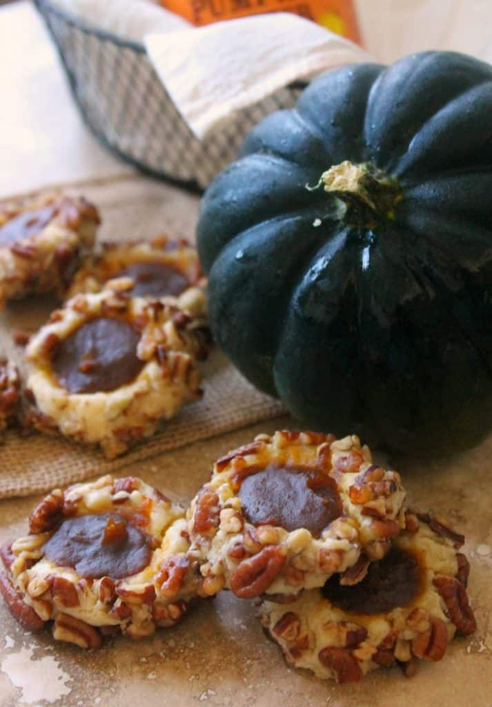 Pumpkin Butter Thumbprint Cookies! The ultimate fall cookies, these sweet treats are rolled in crunchy toasted pecans and filled with a delicious spiced store-bought pumpkin butter. A great cookie to make for fall holidays!