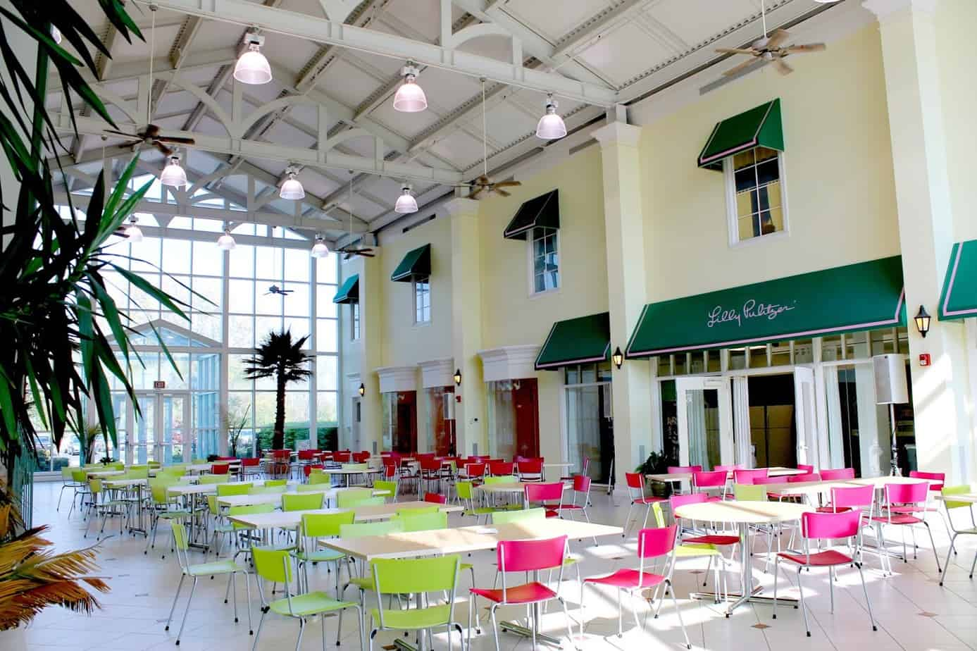 A Glass Atrium Complete With Pink And Green Chairs, Awnings, Ceiling Fans  {that Run Even Through The Cold Winter Months To Keep Everyone In The  Florida ...