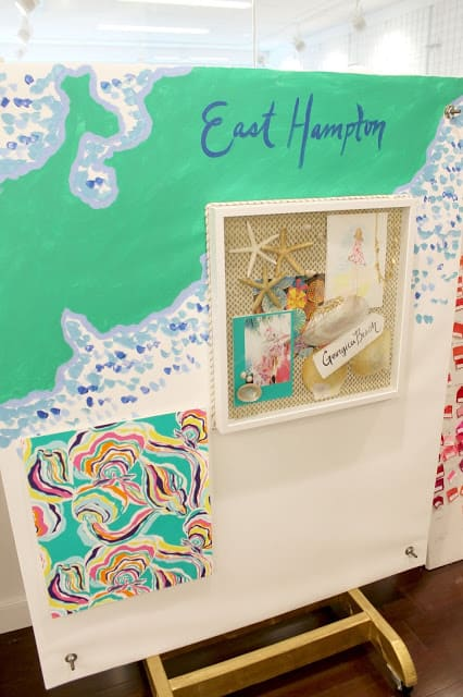 Tropical island mood boards are scattered around the Lilly Pulitzer offices