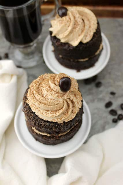 Irish Coffee Chocolate Cakes! Rich, whiskey-infused chocolate mini cakes are layered with sweet, boozy whipped cream in this beverage-inspired dessert.