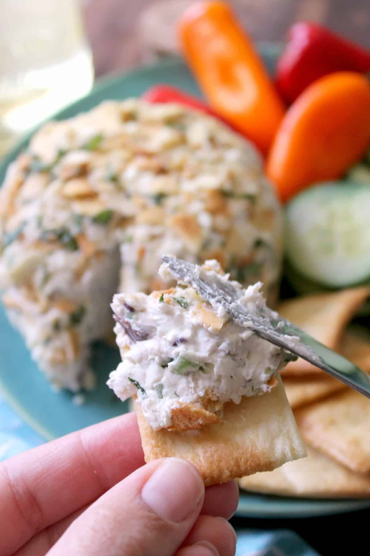 This Easy Greek-Style Cheese Ball is the only recipe you'll need this summer when it comes to quick and simple potluck contributions and last minute entertaining! Bursting with fresh, herbacious flavors that go perfectly with crisp vegetables or crackers, you might have whip up a double batch!