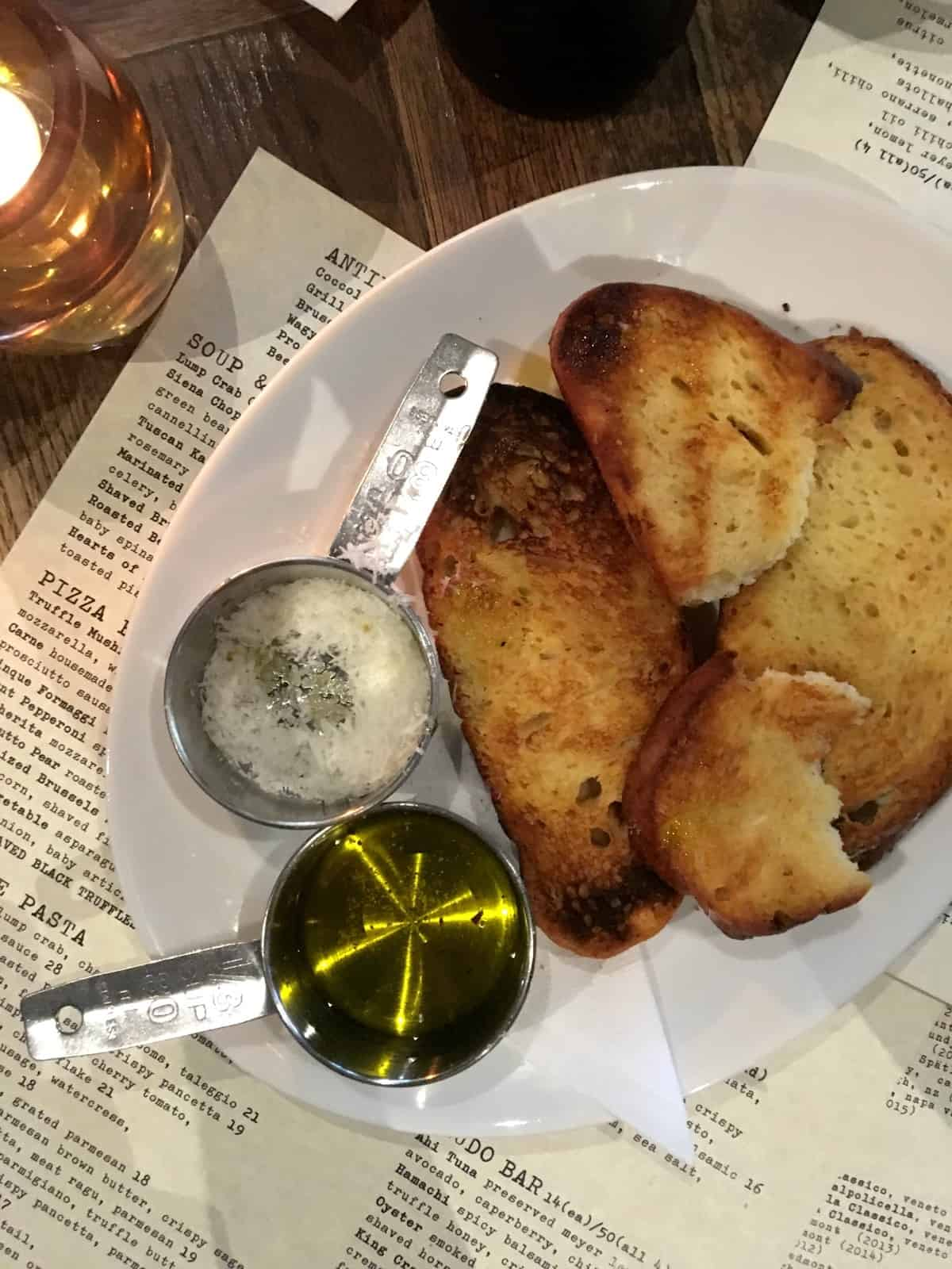 Fresh toasted bread with Parmesan and olive oil