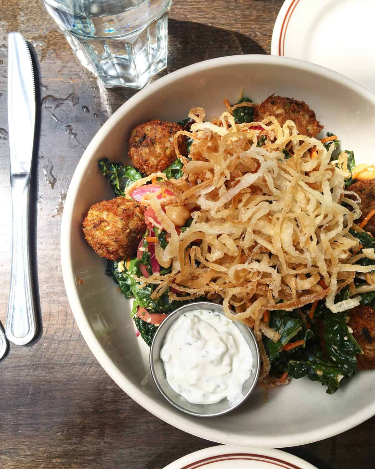 Delicious Kale Salad topped with crispy fried onions