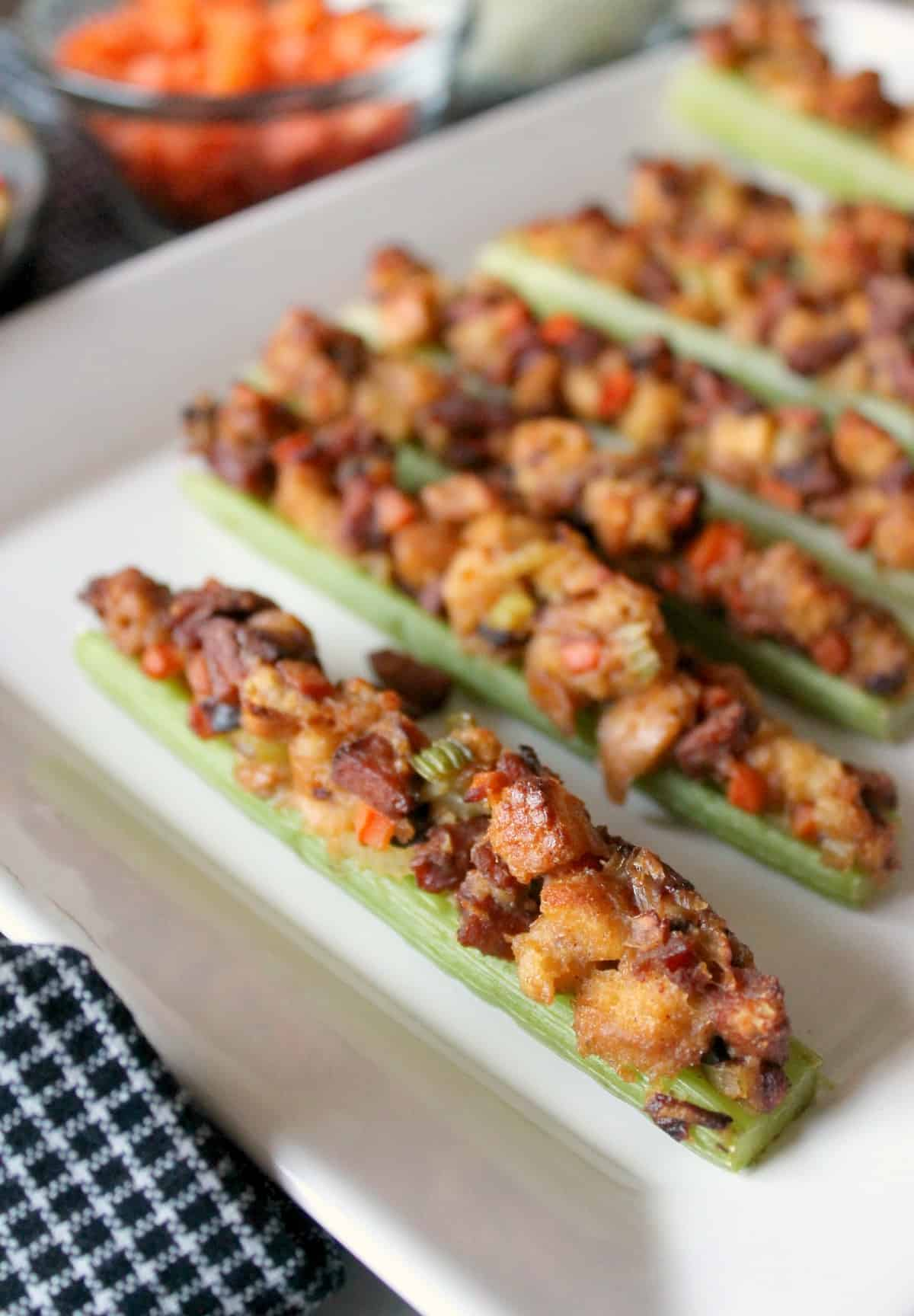 These roasted celery boats are stuffed with cajun style stuffing