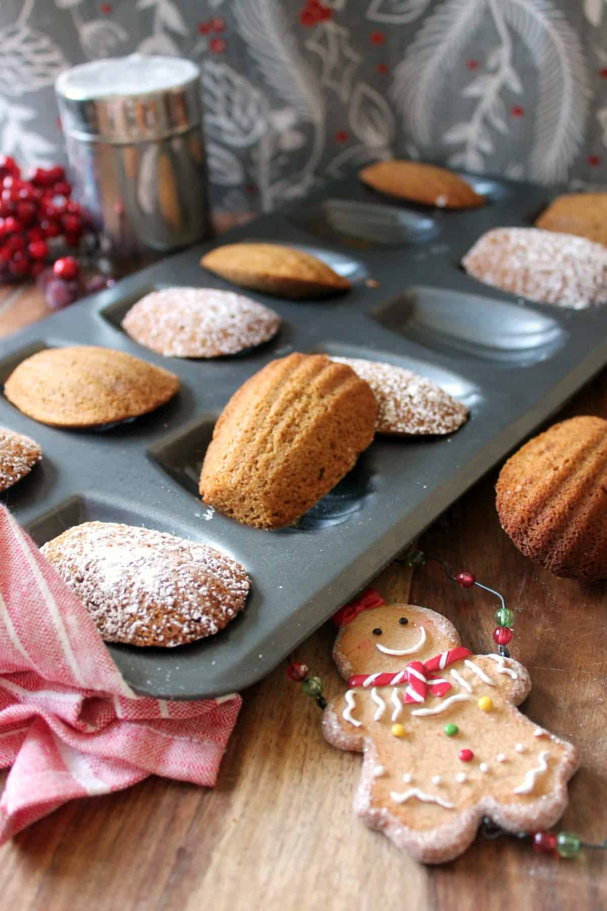 Gingerbread Madeleines. Delicate, cake-like cookies infused with the flavors of gingerbread! A perfect holiday treat.