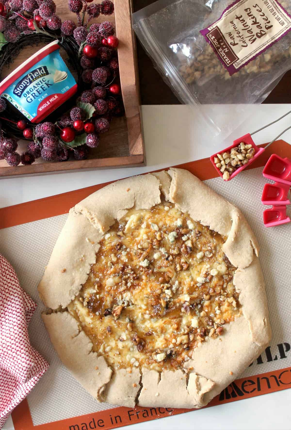 Gorgonzola & Fig Jam Crostata. A tender, rustic tart slathered with a creamy filling and fig jam swirl, topped with savory Gorgonzola cheese and walnuts.