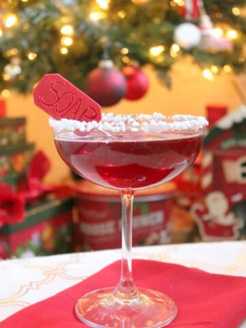 """""""Oh Fudge!"""" Inspired by the Christmas favorite, A Christmas Story, The Lifebuoy Cocktail is anything but a punishment for your taste buds! Flavors of muddled raspberries and vanilla bean simple syrup make this bourbon cocktail a great holiday beverage. No profanity required!"""