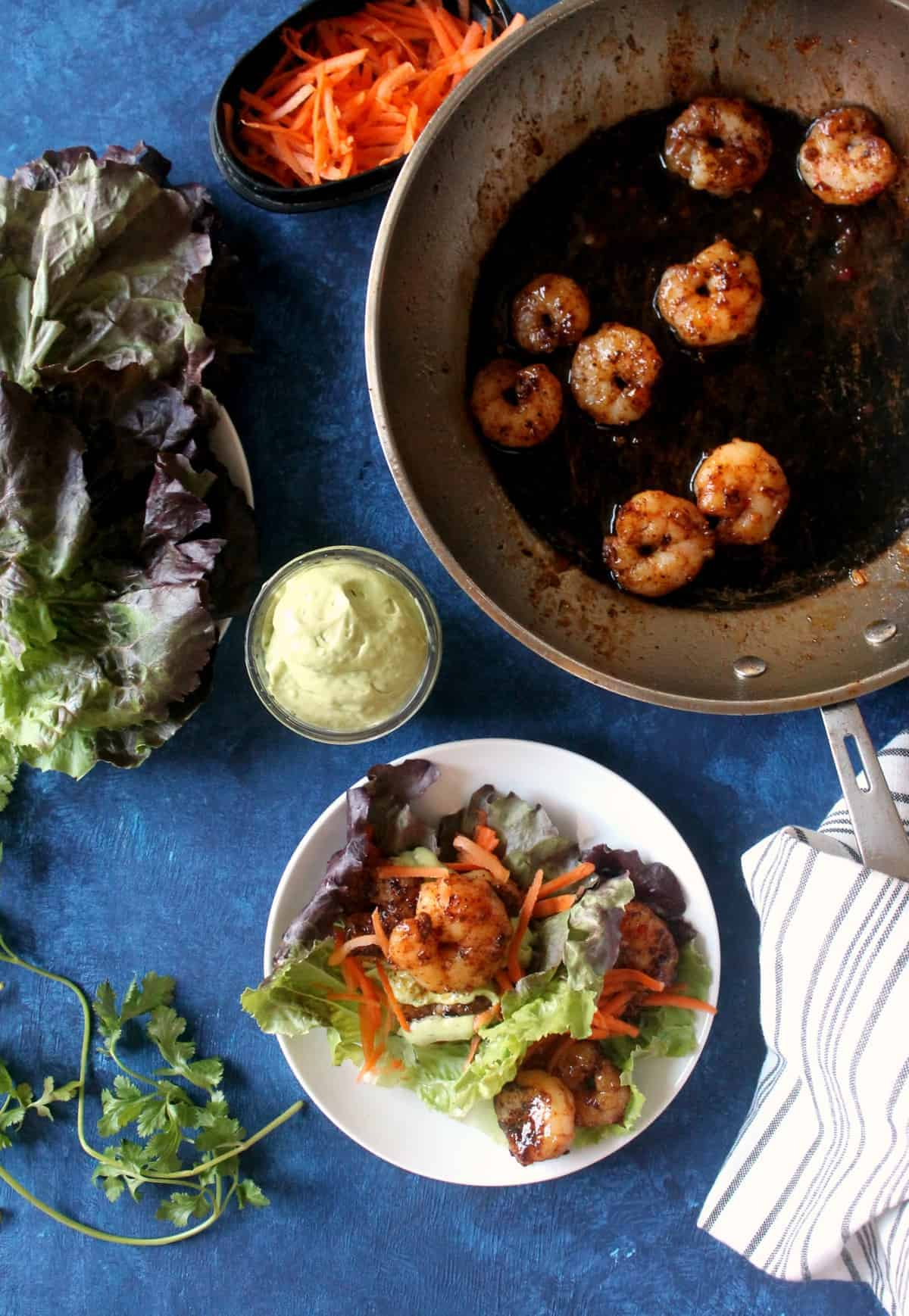 Sweet & Spicy Shrimp Lettuce Wraps with Avocado Cream! These satisfying wraps take just minutes to make but will leave you dreaming about them for days!