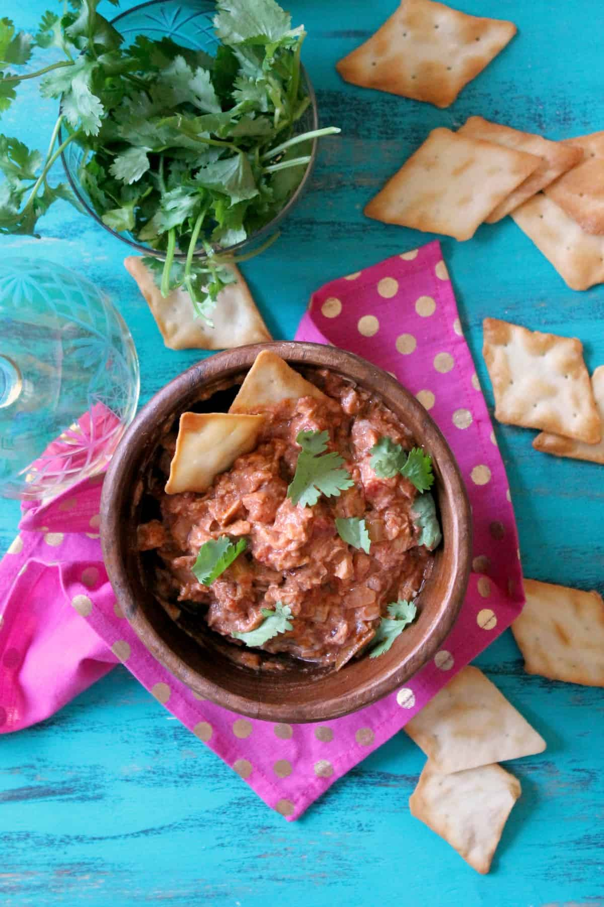 Indian-Inspired Butter Chicken Dip is an exotic twist on the ever popular {but slightly overdone} Buffalo Chicken Dip bursting with fragrant spices and creamy yogurt!