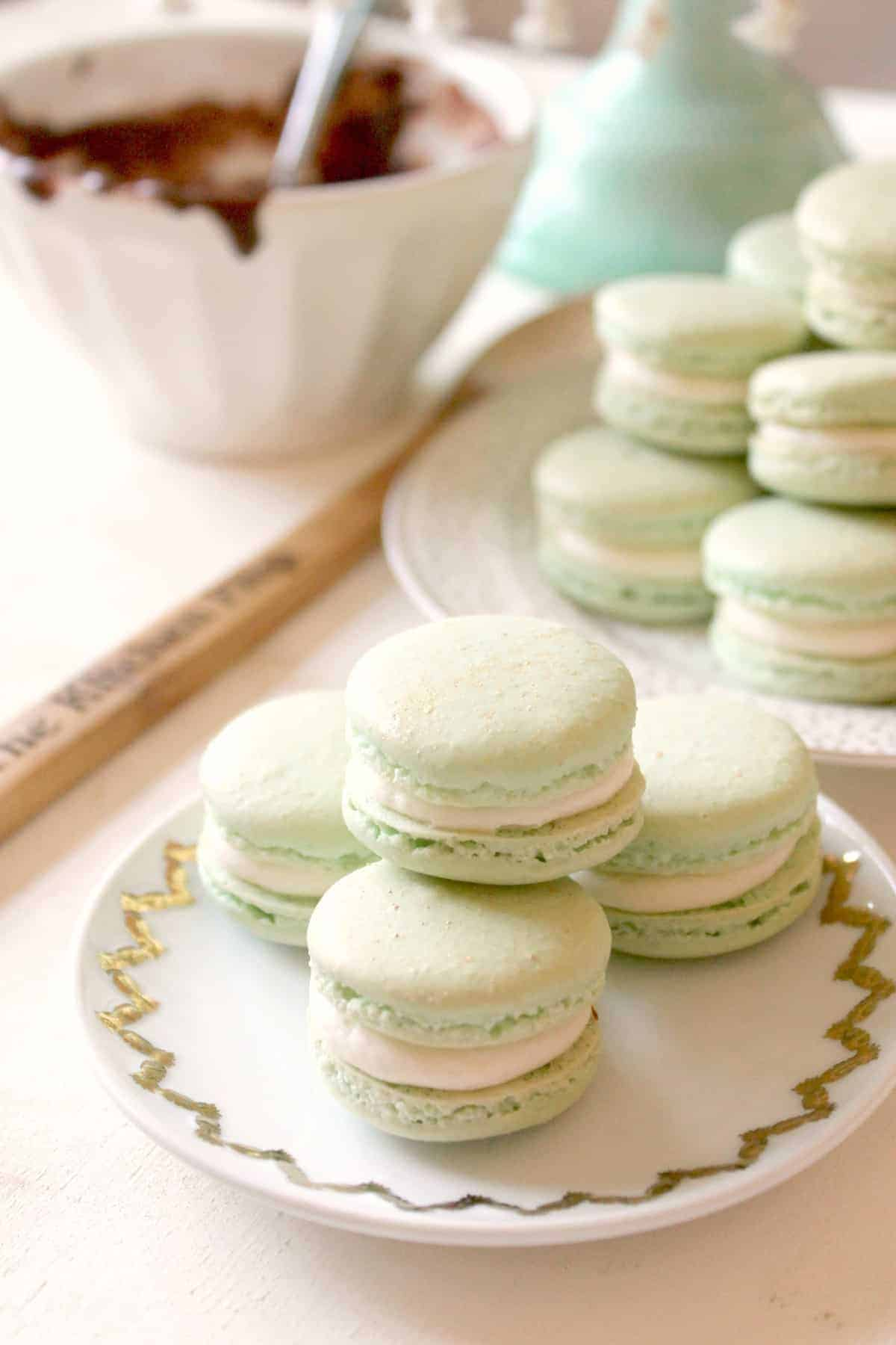 Irish Cream & Milk Chocolate French Macarons! Irish Cream Buttercream and gooey center of rich, milk chocolate ganache are sandwiched by classic macaron shells. Sweet and dainty, these airy little cookies make a perfect dessert for a special occasion.