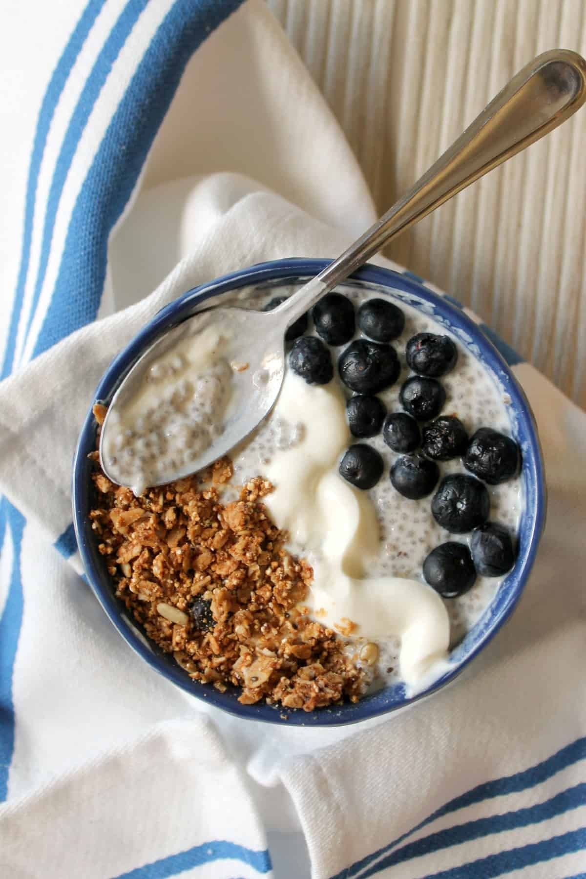 Blueberry-Ginger Chia Pudding -- brimming with nutritious qualities, chia pudding may just become your go-to breakfast or snack! This version is infused with ginger flavor and topped with berries, crunchy granola and a swirl of creamy yogurt.
