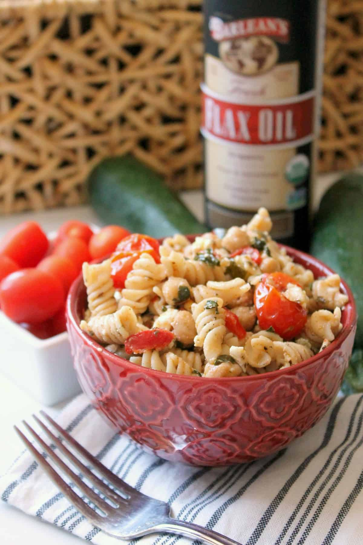 This Healthy Mediterranean Pasta Salad is filled with veggies, beans and is high in Omega-3s thanks to a flax oil dressing that pulls it all together.
