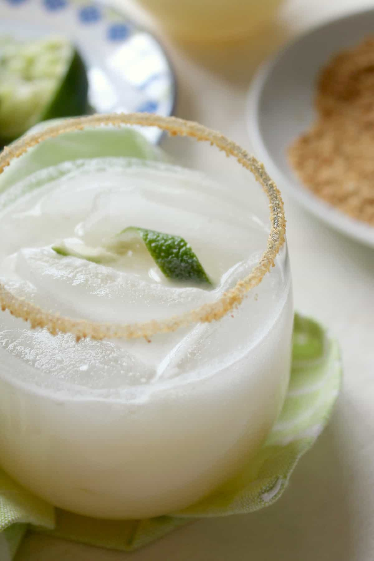 Coconut Key Lime Pie Coolers! The combination of tart lime juice and creamy coconut milk will make you reach for another sip of this tasty drink and remind you of sweet and smooth key lime pie with an extra tropical twist. Rim the glass with crushed graham crackers to drive the flavor home!
