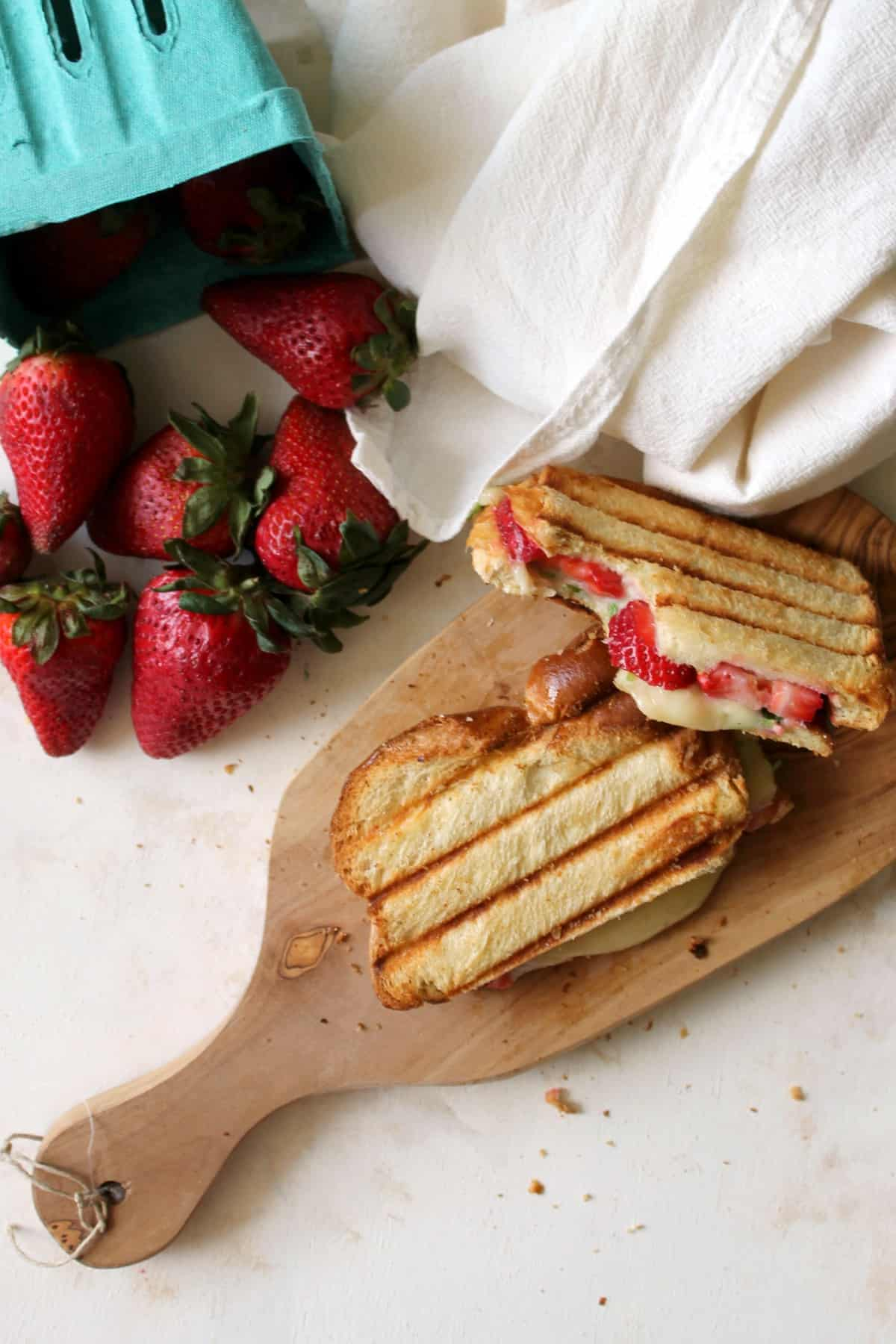 Strawberry, Brie & Arugula Paninis are a simple but delicious way to enjoy ripe, juicy strawberries! A classic comfort food with a springtime twist!