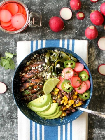 These Portobello Poblano Grain Bowls are both healthy & satisfying! Flavorful veggies sit atop a bed of fluffy quinoa -- you won't even miss the meat!