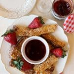 Breakfast gets an upgrade with these Almond-Crusted French Toast Sticks with Strawberry Dipping Sauce! Thick slices of bread are dipped in an orange and almond-scented egg custard, then coated in crunchy sliced almonds and cooked to golden perfection. Sliced into batons, this French toast is ideal for dipping into the pièce de résistance: An orange-liqueur infused strawberry dipping sauce made with Bonne Maman preserves. It's a fantastic recipe for breakfast in bed, brunch or a special gathering.
