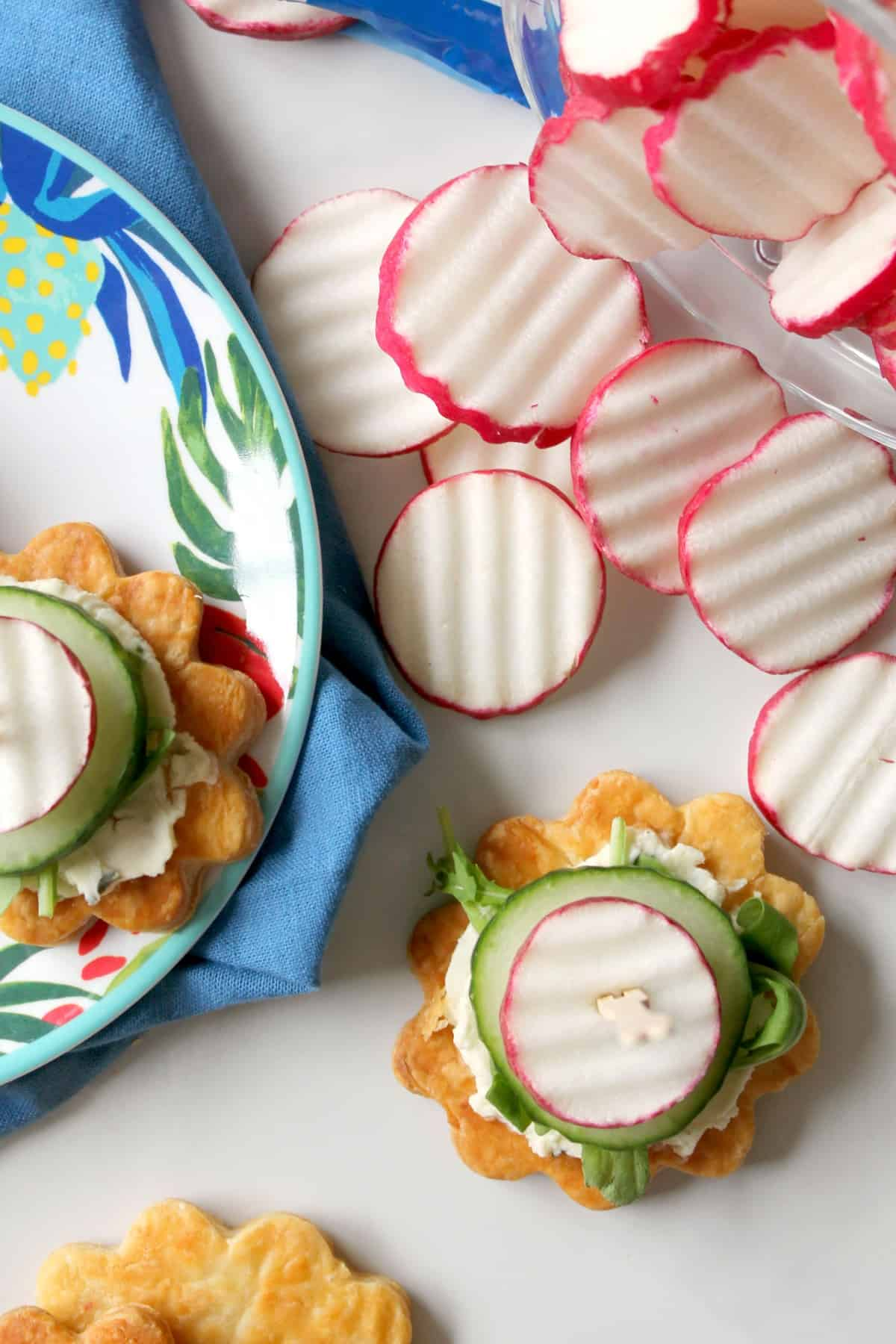 Radish & Cucumber Puff Pastry Bites come together so quickly they'll become your favorite party appetizer! A great addition to spring parties and brunches.