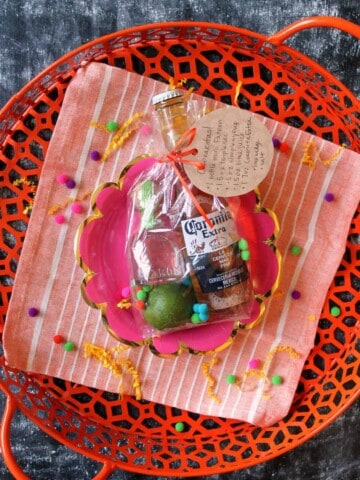 """Let party-goers take the fiesta """"to go"""" with these adorable Margarita Party Favors! A few margarita-making essentials all bundled up in a festive little bag. Bust them out at your Cinco de Mayo party or summer barbecue and there will be """"cheers"""" all around!"""