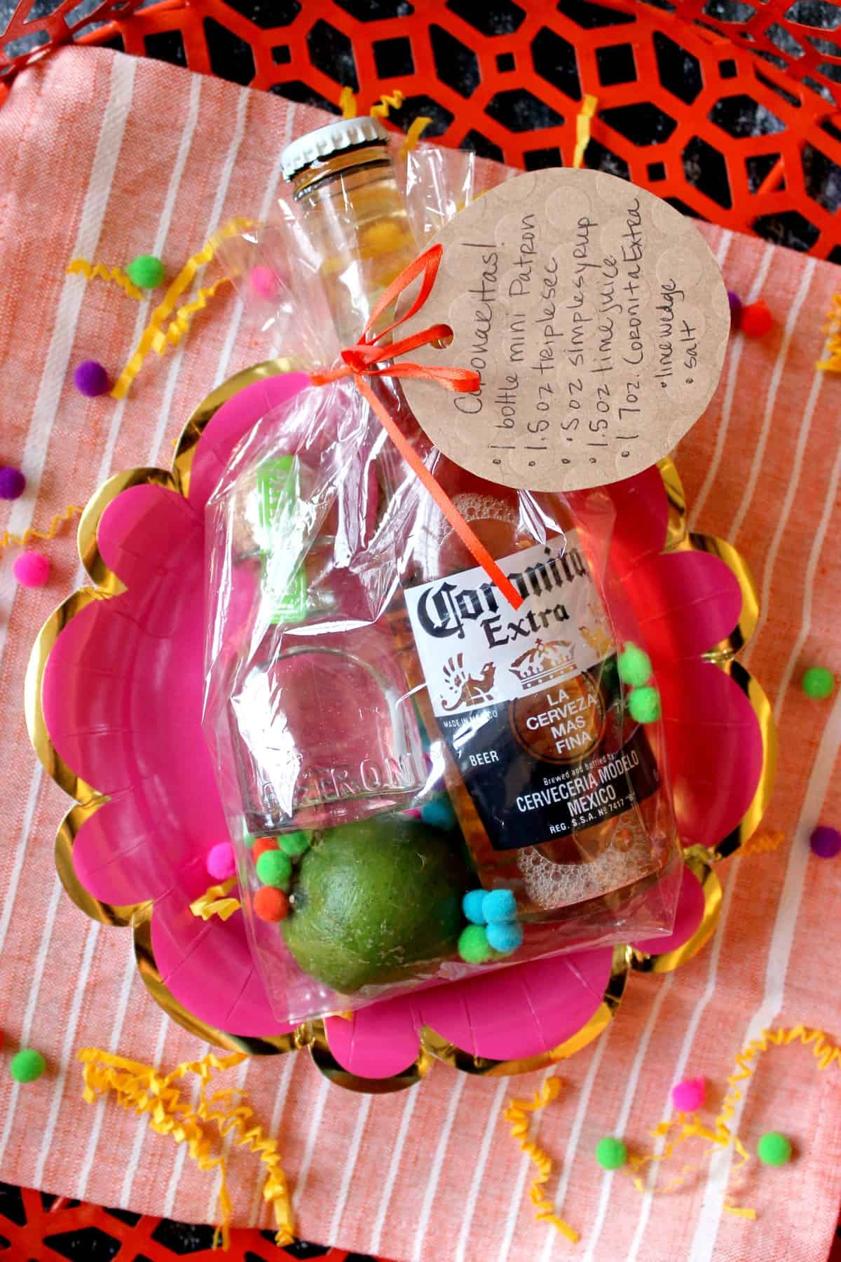 "Let party-goers take the fiesta ""to go"" with these adorable Margarita Party Favors! A few margarita-making essentials all bundled up in a festive little bag. Bust them out at your Cinco de Mayo party or summer barbecue and there will be ""cheers"" all around!"