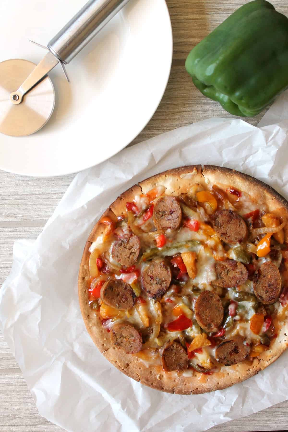 Sausage, Pineapple & Bell Pepper Flatbread. Cancel that pizza order & whip this up in no time; a colorful, sweet and spicy flatbread that will make your taste buds do a hula dance!
