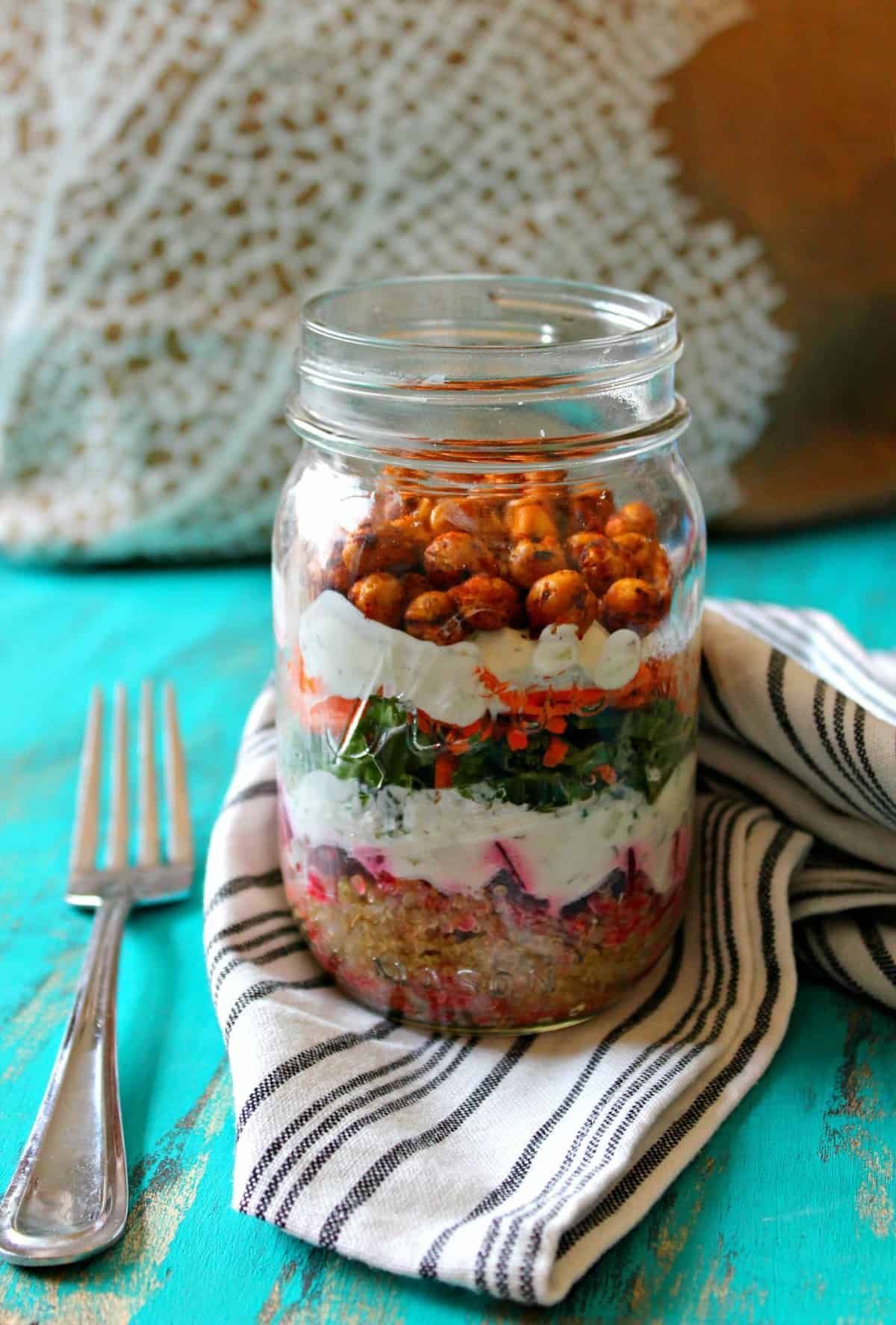 Savory Yogurt Parfaits! Whether you're on the go or simply need a moment to savor a nutritious bite, this layered snack will hit the spot. Quinoa, beets, kale and carrots are divided by a cool, creamy yogurt and cucumber sauce and topped off with flavorful roasted chickpeas for some crunch!