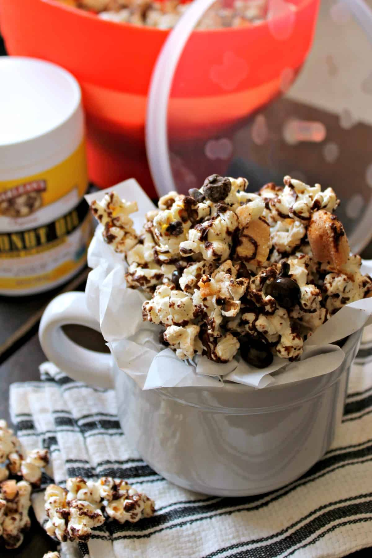 Chocolate drizzled popcorn with toffee and lady finger cookie pieces