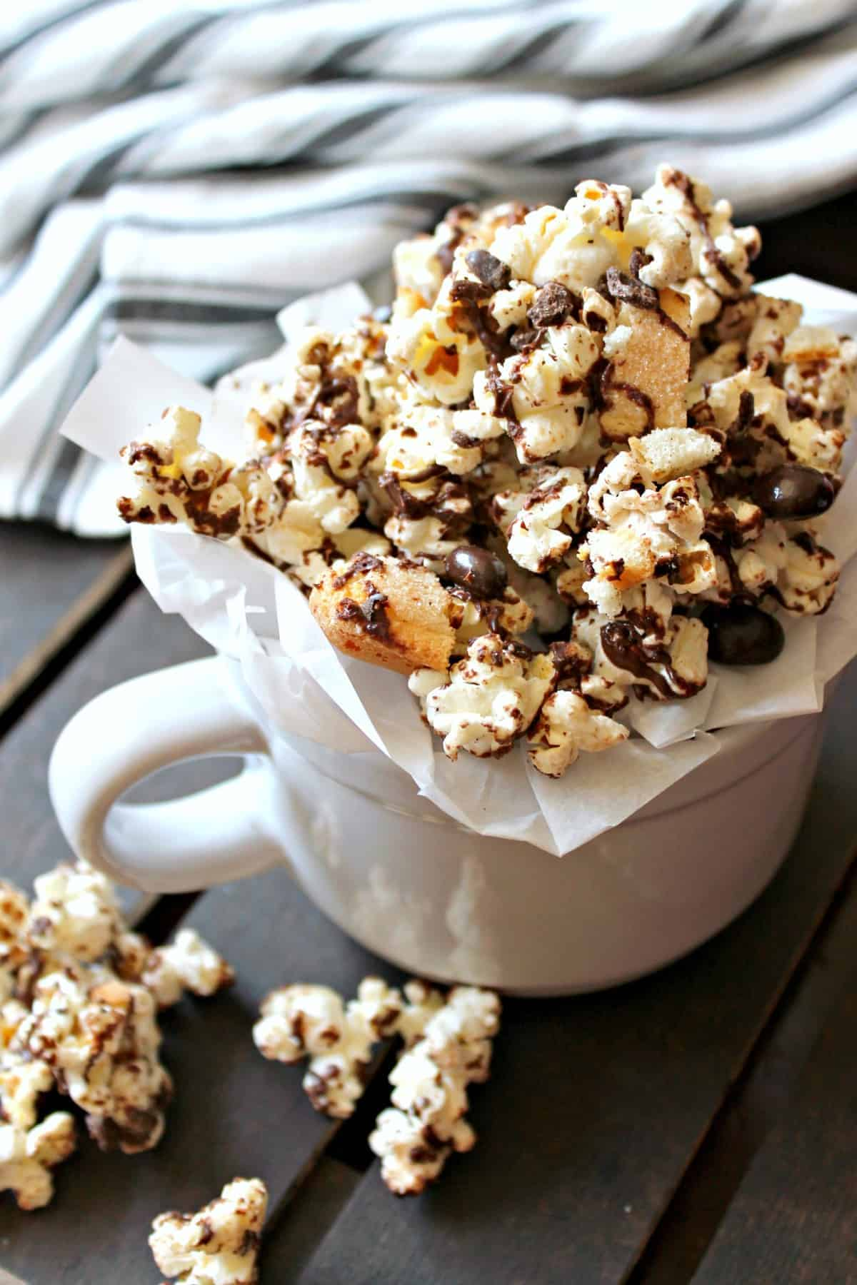 Chocolate and toffee coated popcorn with lady finger cookie bits