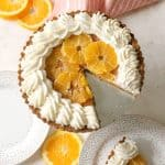 Orange Dreamsicle Tart! A simple crust of pulverized graham cracker and sweetened coconut flakes makes the ideal, tropical vessel for a condensed-milk sweetened citrus custard, lightened with airy, beaten egg whites. Decorated with a halo of fluffy, vanilla-scented whipped cream, this dessert is definitely one heavenly dream!