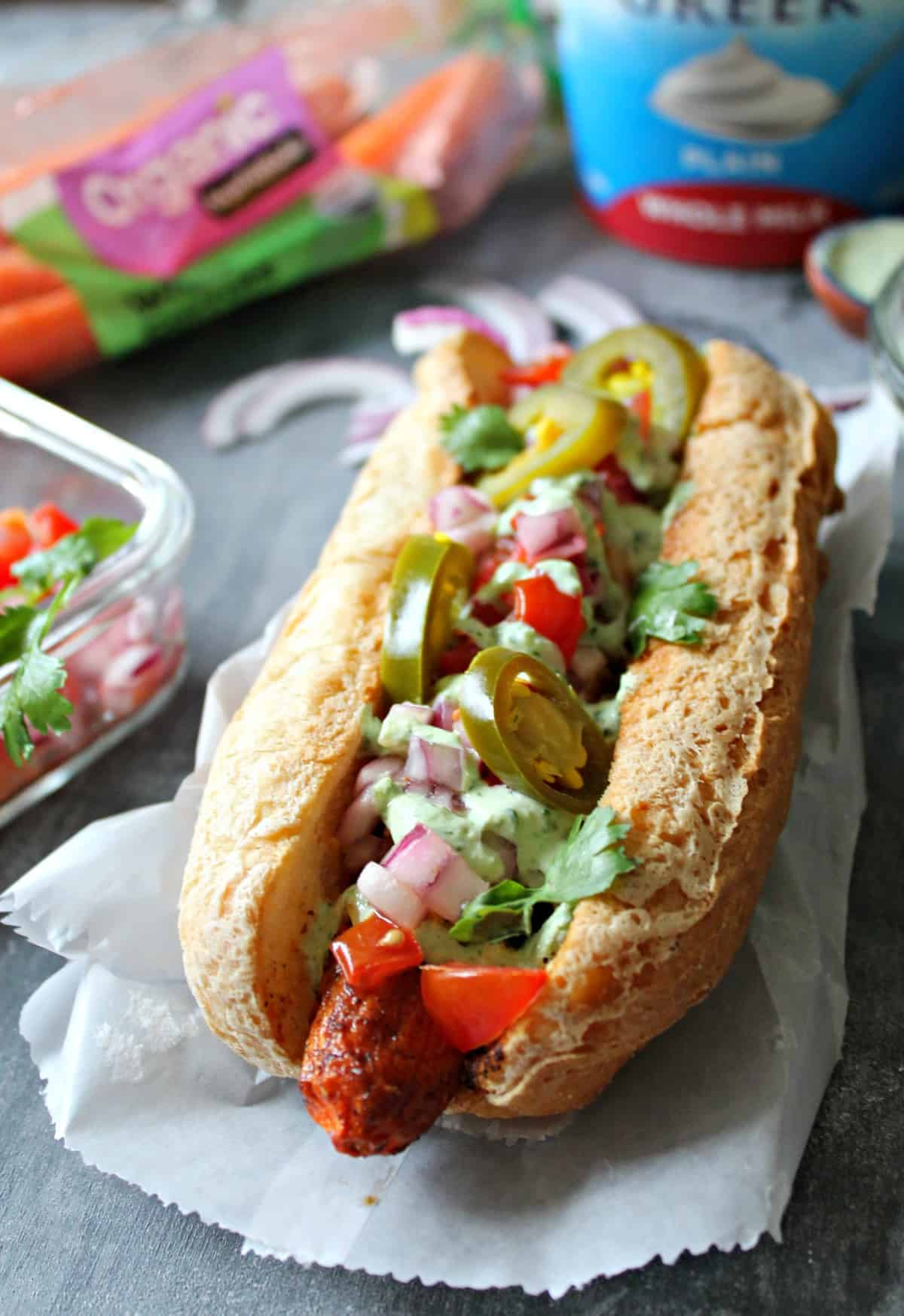 "Tex-Mex ""Carrot Dogs"" with Cilantro Garlic Yogurt Sauce. A meatless version of a summer favorite: Smoky carrot ""hot dogs"" loaded with Tex-Mex toppings!"