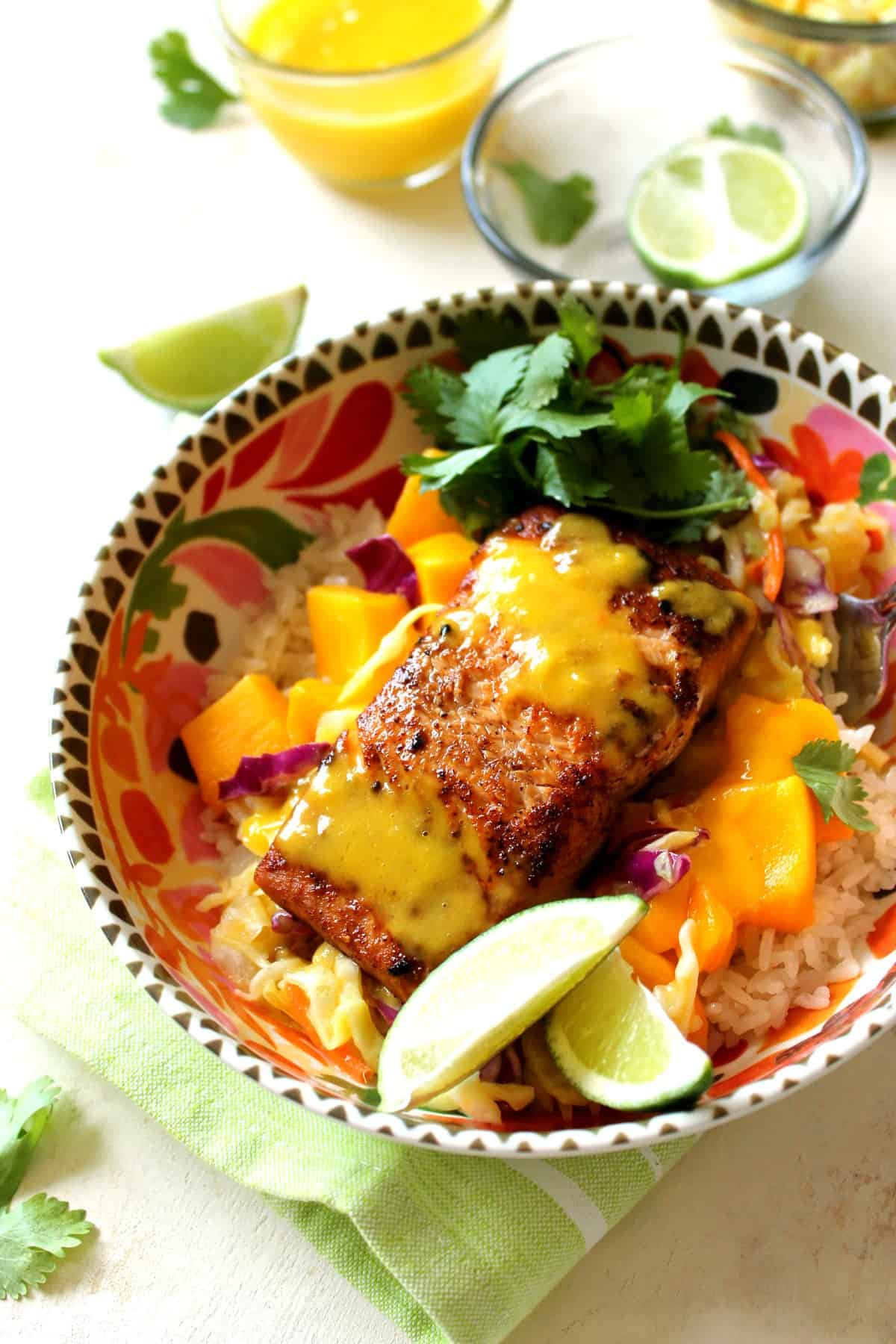 These mango salmon bowls are a healthy, filling lunch made with fresh salmon, coconut rice and a sweet mango sauce with mango chunks