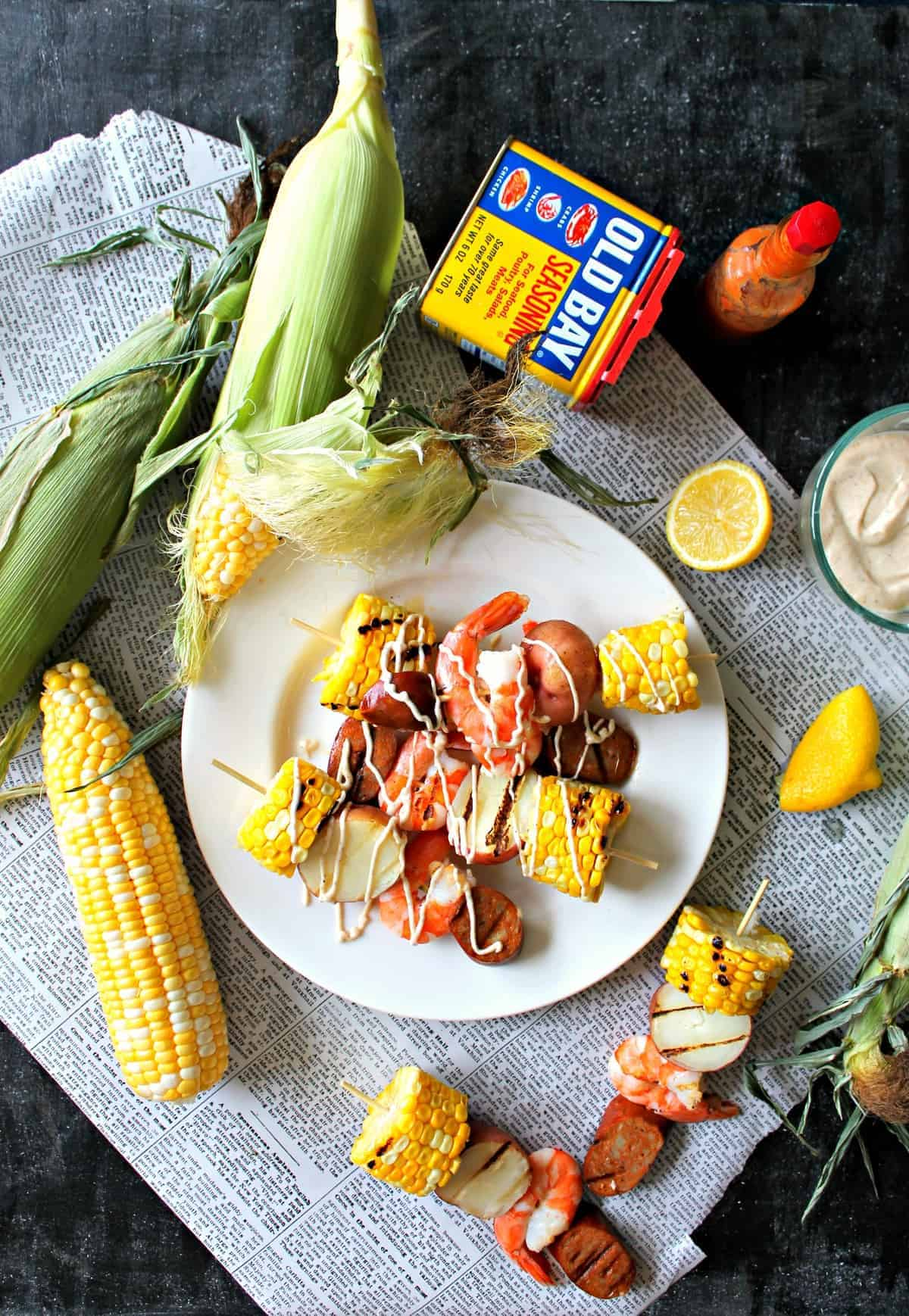 Shrimp Boil Kabobs with Old Bay Aioli -- summer on a stick! Yes, shrimp boils are traditionally casual & messy, but this skewered version adds a touch of sophistication that makes it a fantastic addition to even elegant summer gatherings.