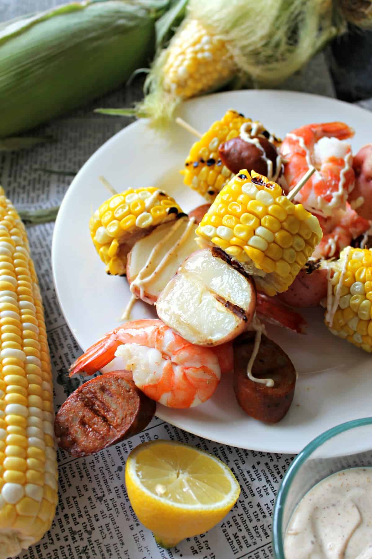 Shrimp Boil Kabobs drizzled with a homemade Old Bay seasoning aioli is summer on a stick