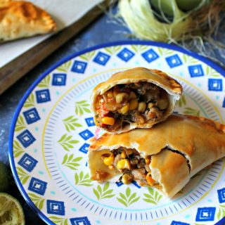 Need a new way to use up that summer sweet corn? These Baked Crab and Corn Empanadas are a handheld savory snack that's bursting with flavor and fun to eat! Baked instead of fried, they're a lightened up version of a classic Latin American bite.