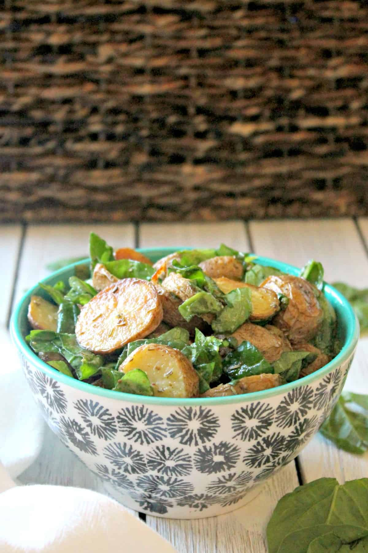 Roasted Potato & Spinach Salad! No mayo here, just a bright and tangy vinaigrette that makes this simple potato salad equally scrumptious. Served warm or at room temperature, it's a versatile, crowd-pleasing side dish you'll make again and again.