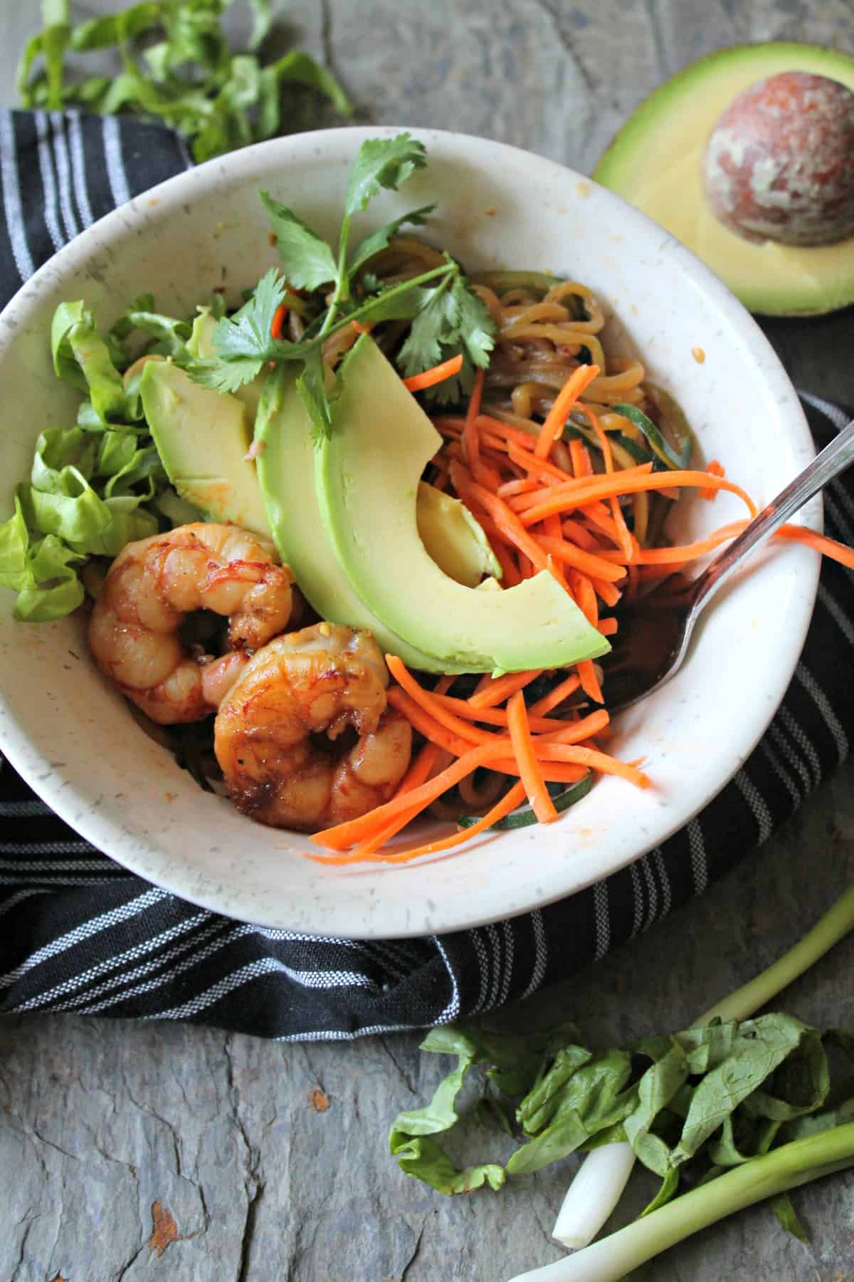 Shrimp & Avocado Zoodle Salad Bowls! Add your favorite protein to these these healthful zucchini noodle bowls for a quick weeknight meal you'll love!