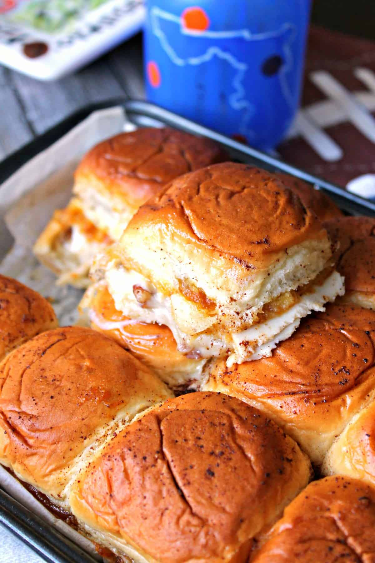 Baked Pumpkin Butter Turkey & Cheese Sliders. The ultimate bite of fall flavors: Pumpkin butter, turkey, pecans & melted cheese baked to buttery perfection!