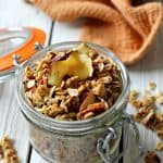 Warm spices, pecan bits and dried apple add a hint of seasonal flavor that will quickly make this Spiced Apple Pecan Granola your preferred fall snack!