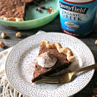 Hazelnut Chocolate Chunk Pie with Yogurt Whipped Cream! Not a fan of traditional pies? This fudgey version is filled with chocolate chunks & hazelnuts!