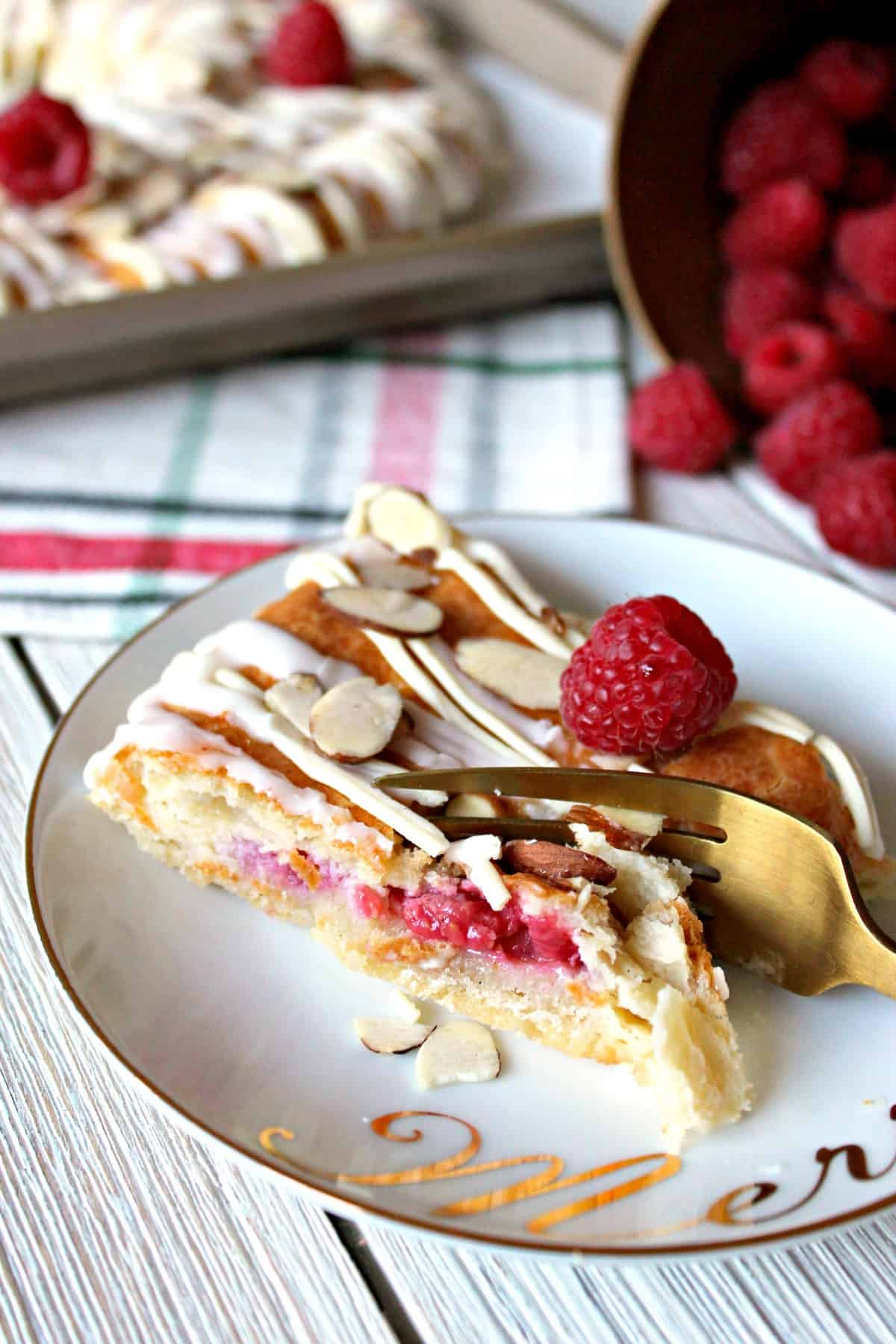 Raspberry White Chocolate Almond Kringle! Beautiful pastry studded with fresh raspberries, sweet drizzle & crunchy almonds. A perfect holiday breakfast.