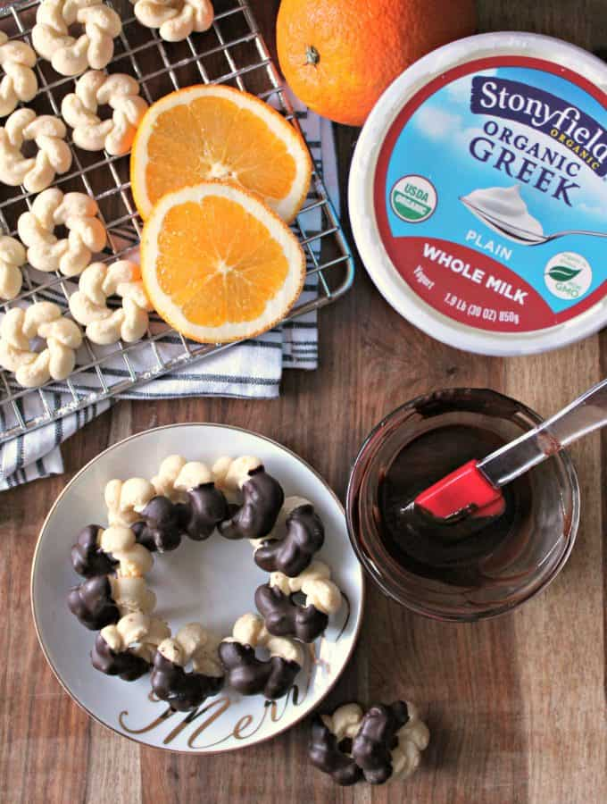 Chocolate-Orange Yogurt Spritz Cookies. Dainty and delicate, these orange-scented cookies are a spin on a classic spritz cookie with the addition of yogurt and a dip in rich dark chocolate.
